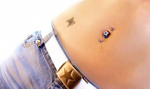 Татуировки на животе у девушек